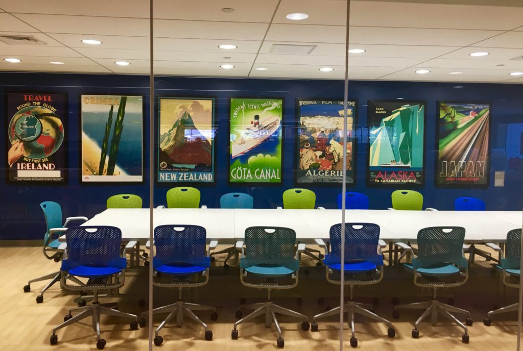Conference room with travel posters.